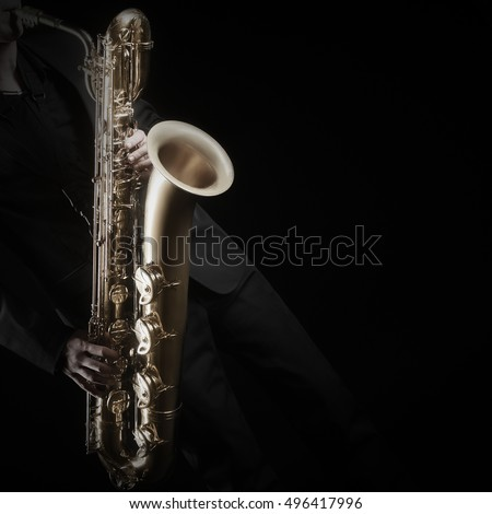 Saxophone Player Saxophonist playing jazz with baritone. Sax player with music instrument