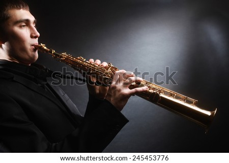 Saxophone player. Saxophonist with soprano sax Man with musical instruments - stock photo