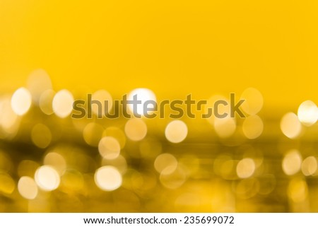 Saxophone's bokeh on the yellow background - stock photo