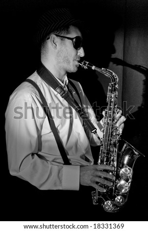 Saxophonist Series: Musician with his shadow - stock photo