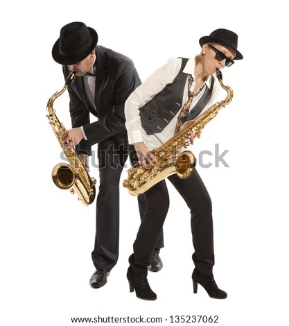 Saxophonist. Woman and man playing on saxophone isolated on background - stock photo