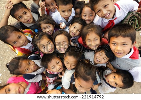 SAYABOURY, LAOS, FEBRUARY 16, 2012: group of joyful unidentified kids posing during the Elefantasia festival on February 16, 2012 in Sayaboury, Laos - stock photo