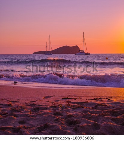 Saying goodbye to a beautiful day from a lovely beach in Ibiza - stock photo