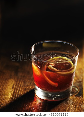 sazerac cocktail on dark wooden background with copy space - stock photo