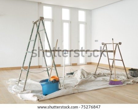 Scaffold in a white room with parquet - stock photo