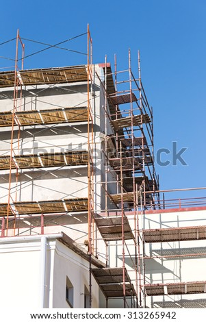 scaffold surrounding old house during renovation works