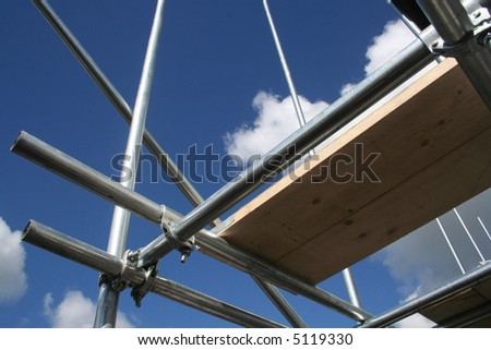 Scaffolding against blue sky