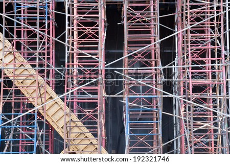 Scaffolding along side a building under construction in New York City. - stock photo