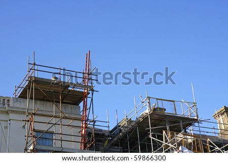 Scaffolding and ladder on outside of large house
