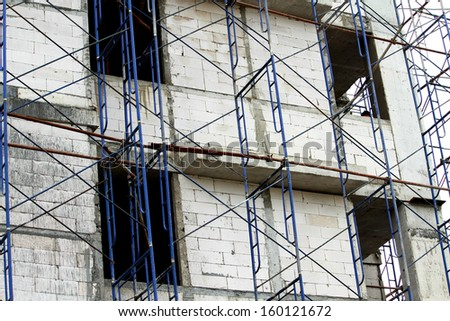 Scaffolding ,building construction  - stock photo