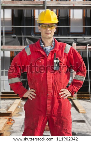 Scaffolding metal stand on an unfinished industrial construction site - stock photo