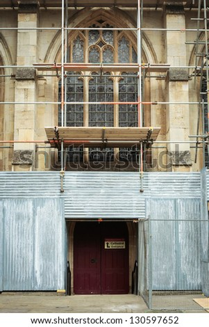 Scaffolding on a medieval english church undergoing repairs