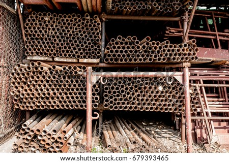 Scaffolding Storage Area In Outdoor, Detail Of Stacks Of Pipes, Poles, Used  And