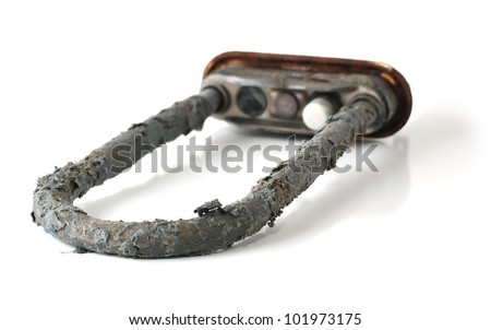 Scale and deposits on the heating element of a washing machine on a white background