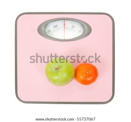 Scale and fruits Isolated on White with Clipping Path - stock photo