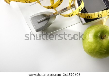 Scale with apple and tape measure isolated. Concept health, diet and nutrition. Horizontal composition. Top view - stock photo