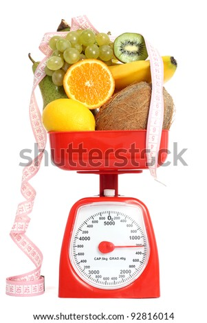 Scale with fruits - stock photo