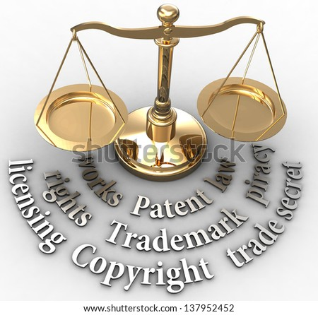 Scale with intellectual property concepts of patent copyright trademarks - stock photo