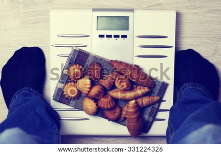 Scales calories pastry weight - stock photo