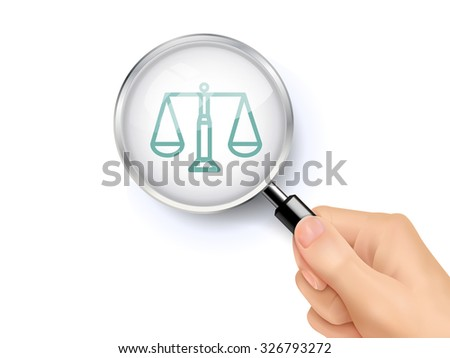 scales of justice icon showing through magnifying glass held by hand - stock photo