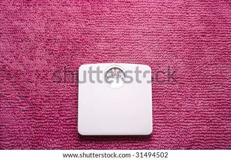 Scales on pink rug landscape - stock photo