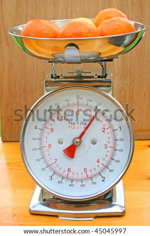 Scales with fruit. - stock photo