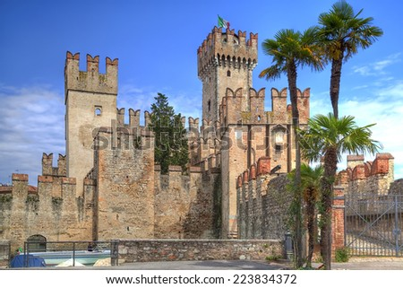 Scaliger Castle in Sirmione at the Lake Garda in Italy in historically and playful architecture - stock photo