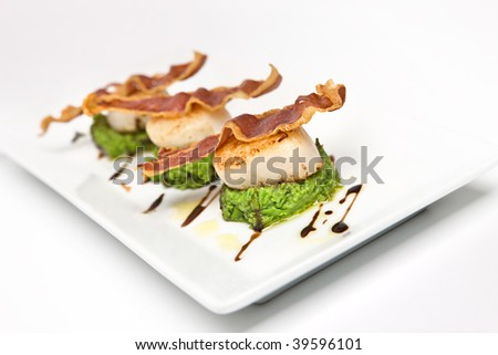 scallop starter with bacon and pea puree - stock photo
