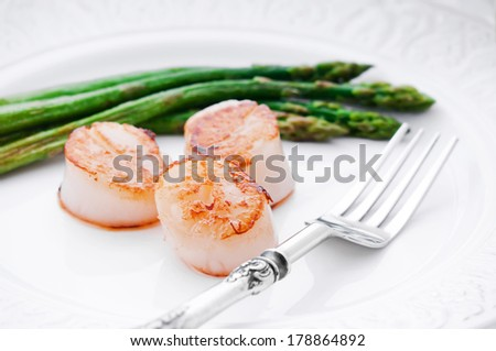 Scallops with asparagus, serving for dinner - stock photo