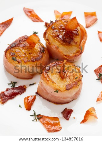 Scallops wrapped in bacon and seared, close-up - stock photo