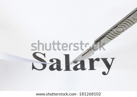 Scalpel cutting through the word Salary. Concept denoting a cut in income or salary caused by economic troubles and a lowering of standard of living. - stock photo