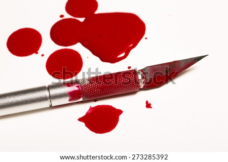Scalpel knife blood mess - stock photo