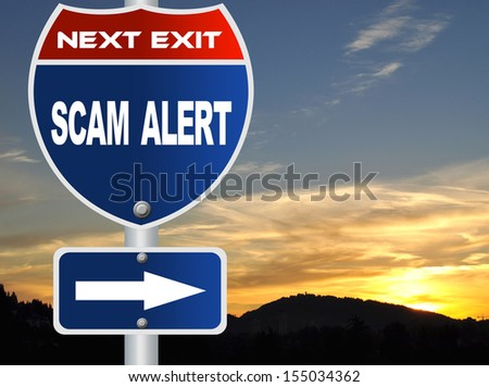Scam alert road sign - stock photo