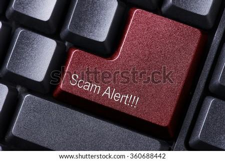 Scam Alert written on keyboard button - stock photo