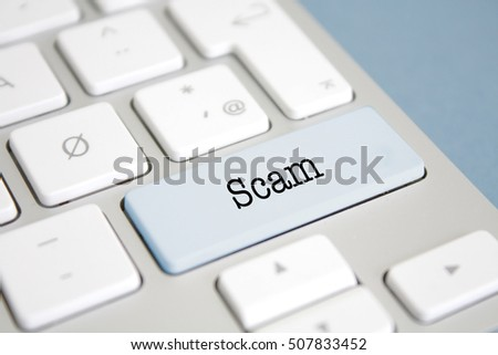 Scam written on a keyboard