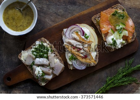 Scandinavian open sandwiches with mackerel, salmon and herrings