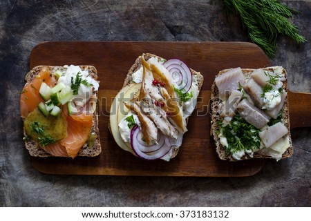 Scandinavian open sandwiches with salmon, mackerel and herrings - stock photo