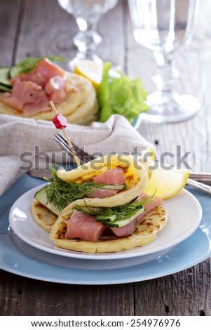 Scandinavian potato pancakes with salmon, dill and cucumber - stock photo