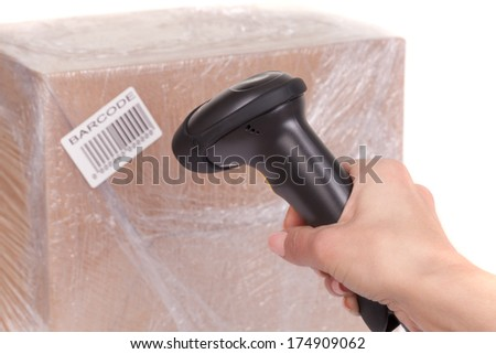 Scanning boxes with  barcode scanner  - stock photo