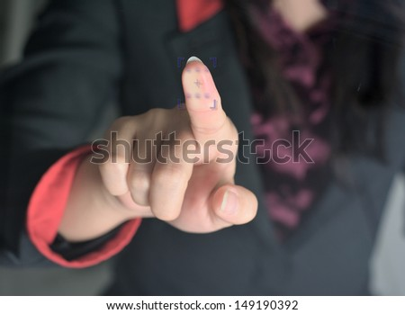 scanning of a finger on a touch screen interface - stock photo