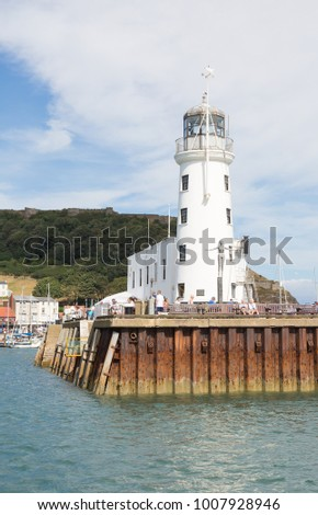 SCARBOROUGH, ENGLAND - SCARBOROUGH HARBOUR 26th AUGUST 2016, Scarborough lighthouse with the Diving Belle at Scarborough Harbour, a popular tourist destination. UK 26th August 2016
