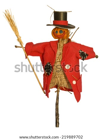 Scarecrow for the garden with a broom in his hand. The head of a pumpkin for Halloween holiday - stock photo