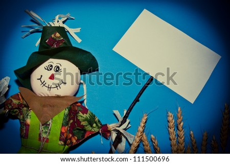 Scarecrow holding a sign - stock photo
