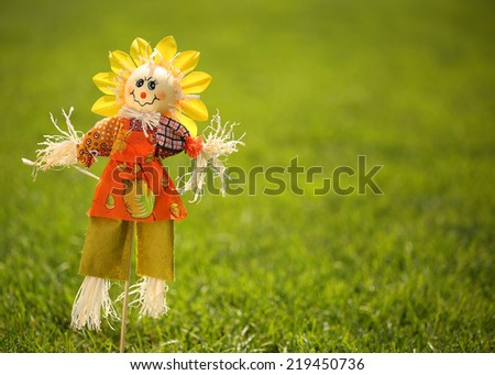 Scarecrow in Garden. - stock photo