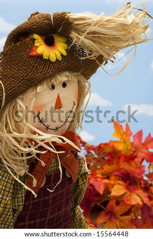 Scarecrow on autumn background with copy space - stock photo