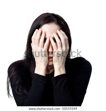 Scared abused woman hiding behind her hands. Isolated image - stock photo