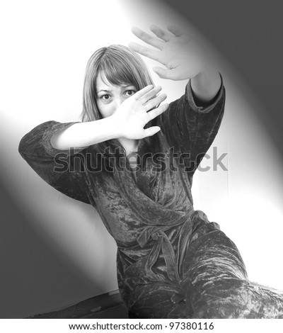Scared abused woman is hiding - stock photo