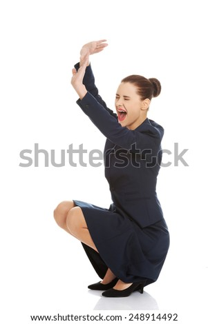 Scared business woman defending herself. - stock photo