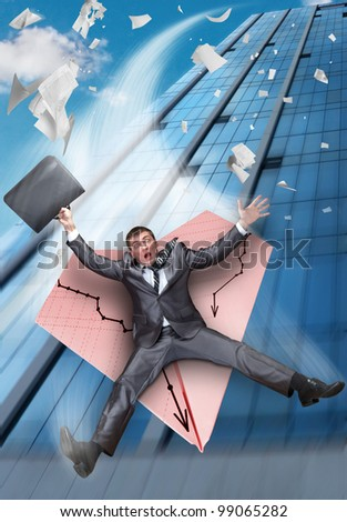 Scared businessman on paper airplane falling from business building - stock photo