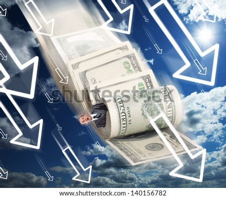 Scared businessman rolled in money falling down - stock photo